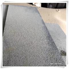 Bush hammered black basalt tiles
